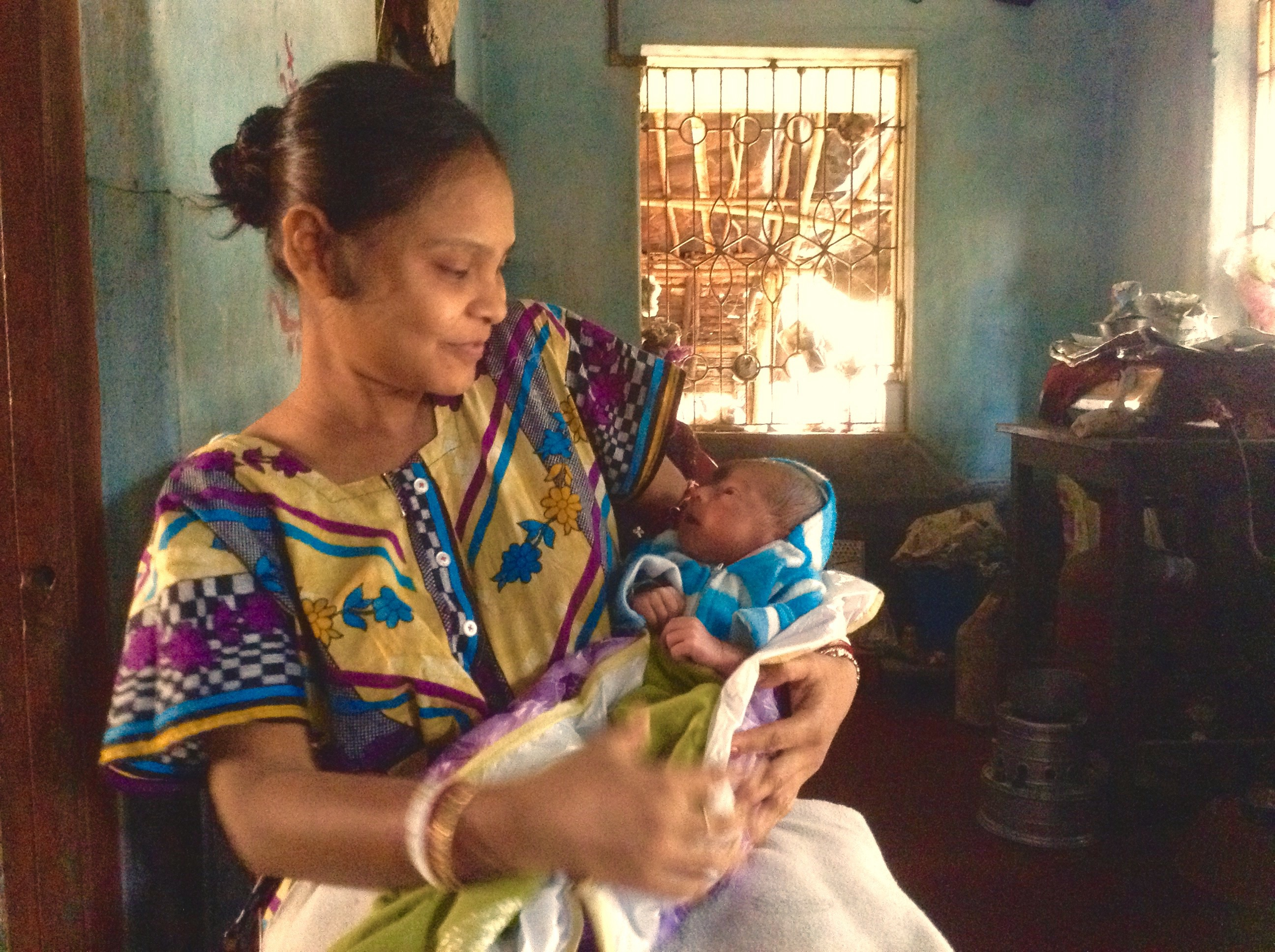 Munmun with her son, ten days after he was born. She named him Soumayan. Photo by Sohini Chattopadhyay